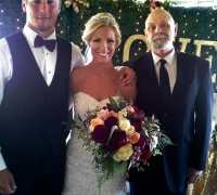 Bride and Groom with wedding officiant